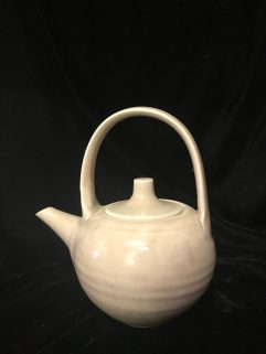 Teapot - Partly oxidised copper red glaze , ceramic handle