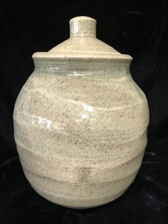 Jar - over irregularly thrown body with light Celadon glaze
